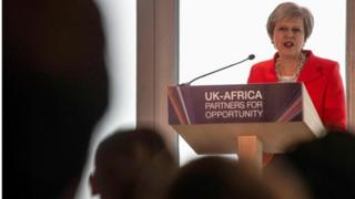 Theresa May addressing business leaders in Cape Town