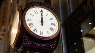A clock sits outside of Trump Tower