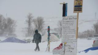protester in snow storm