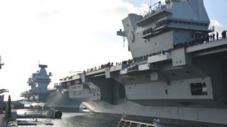 HMS Queen Elizabeth (right) alongside HMS Prince of Wales