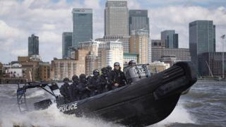Armed Metropolitan Police counter terrorism officers take part in an exercise on the River Thames in London on August 3, 2016.