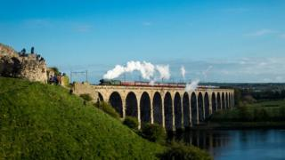The Flying Scotsman passes over the Royal Border Bridge that spans the River Tweed between Berwick-upon-Tweed and Tweedmouth