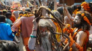 An Indian naked sadhu (Hindu holy man) gestures as he takes part in a religious procession towards the Sangam area during the 'royal entry' for the upcoming Kumbh Mela festival in Allahabad on January 1, 2019