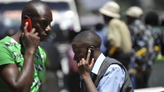 Men using phone