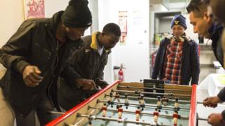 Migrants from Sudan playing table football in Strasbourg, France - Wednesday 26 October 2016