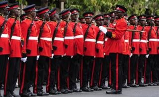 "A guard of honour of the Kenyan Army stand outside the parliament buildings in Nairobi on March 15, 2017, before Kenyan President""s final State of the Nation address"