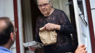 Tamara Lycholaj, 89, receives a hot meal from nutrition worker Al Patalona from the Sullivan County Office for the Aging as he makes 'Meals on Wheels' deliveries