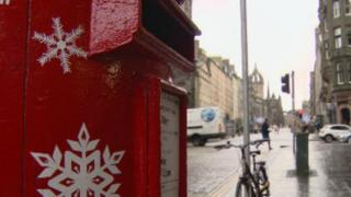 Snow-flake painted post-box