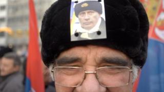 Slika Putina na šubari jednog od građana na dočeku