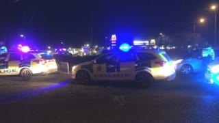 Police vehicles at the scene in St Leonards
