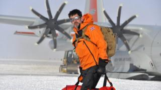 Justin Rowlatt in the Antarctic snow with bags