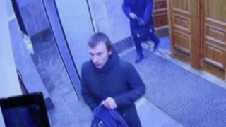 A CCTV image shows a teenager suspected of detonating a homemade bomb in the lobby of an office of the Russian Federal Security Service (FSB) in Arkhangelsk