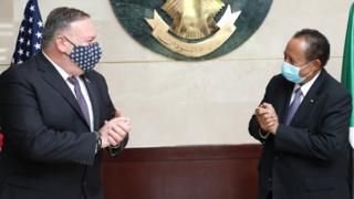 Mike Pompeo w=with Sudan's PM