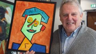 Tony Wates with a self-portrait