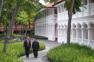 Trump and Kim stroll around the property