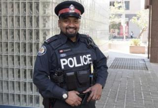 Toronto police Constable Niran Jeyanesan, who bought a teenager a shirt and tie he tried to steal for a job interview