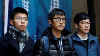 Pro-democracy activists (L-R) Joshua Wong, Alex Chow and Nathan Law outside the Court of Final Appeal