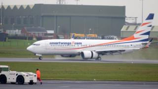 A flight carrying the 51 refugees landed at Belfast International Airport on Tuesday