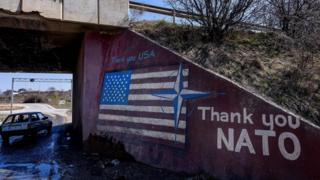 Graffiti with a US flag saying 'Thank you Nato'