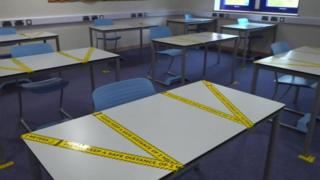 Taped off classroom desks
