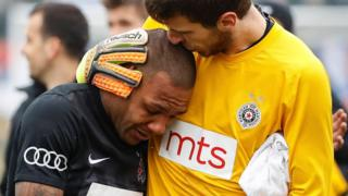 Partizan goalkeeper Filip Kljajic comforts Brazilian Everton Luiz who suffered racist abuse, 19 Feb 17