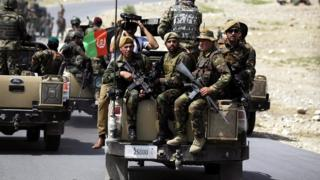 Afghan Army soldiers secure the area in Koh district of Nangarhar province,