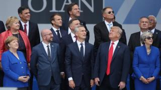 Nato leaders watch a fly-past at the start of the Brussels summit