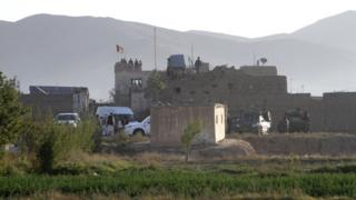 Afghan security forces personnel on the roof of the main prison building after the attack