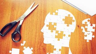 A paper jigsaw of a human head