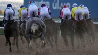 Jockeys compete in a race at the Dubai World Cup meeting 26/03/2016