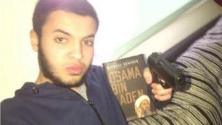 Tarik Hassane, 22, sent his friends a photograph of himself holding a handgun and a book about Osama Bin Laden, the court heard