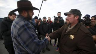 Ammon Bundy (L) meets Sheriff David Ward on a road south of the Malheur National Wildlife Refuge near Burns, Oregon. 7 Jan 2016