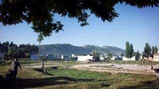 Landscape shot showing the razed compound
