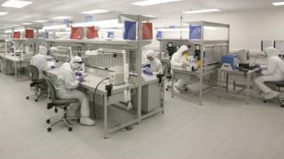 Vascutek staff working in cleanroom