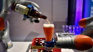 Robotic arm pouring a beer at G20