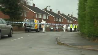 Police and forensics at the scene in Llay