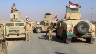 Iraqi forces gather within the Rawa area on 11 November 2017