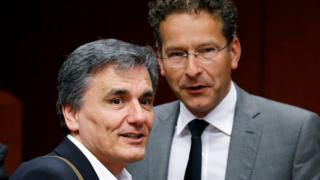Greek Finance Minister Euclid Tsakalotos and Dutch Finance Minister and Eurogroup President Jeroen Dijsselbloem (R) attend an extraordinary meeting of eurozone finance ministers on Greece at the European Council in Brussels, Belgium, May 9, 2016
