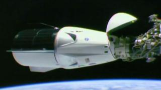 The Dragon capsule lifted its nose cone to make the docking