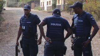 Police secure the area where 11 men were shot dead in Monte Tchota, Cape Verde - 26 April 2016