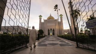 A Muslim man walks inside the Sultan Omar Ali Saifuddien mosque to perform the sunset prayer in Bandar Seri Begawan, Brunei, 1 April 2019