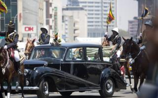Zimbabwean President Robert Mugabe (seated R) and his wife Grace Mugabe (L) arrive aboard a vintage Rolls Royce before the official opening of the Fourth Session of the Eighth Parliament of Zimbabwe in Harare, Zimbabwe, 12 September 2017. The Fifth Session will be the last before the 2018 elections of which the date is yet to be set.