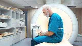 Man at MRI scanning clinic