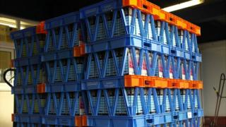 Guernsey milk cartons stacked up