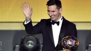 Lionel Messi with the Ballon d'Or in 2015