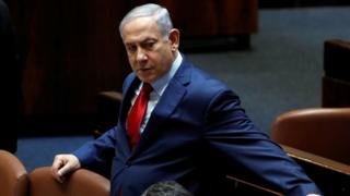 Israeli Prime Minister Benjamin Netanyahu arrives to the plenum at the Knesset