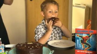 Daniel with birthday cake