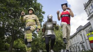 A photo of Firefighter Kevin Summerhayes, Sir Runalot, and Alec Care