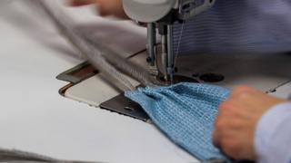 An employee sews pleats into a mask at NorthCape, an outdoor furniture upholstery manufacturer, in Alsip, Illinois, USA, 31 March 2020