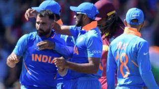 India's Mohammed Shami (L) celebrates with teammates